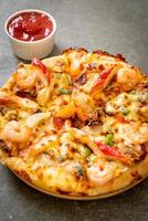 Seafood of shrimp, octopus, mussel and crab pizza on wood tray photo