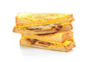 French toast ham, bacon, and cheese sandwich with egg isolated on white background photo