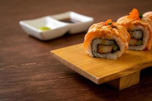 Grilled salmon sushi roll with sauce - Japanese food style photo