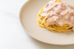 Homemade spaghetti white cream sauce with ham - Italian food style photo
