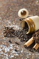 Spices and herbs. Food and cuisine ingredients. Cinnamon sticks, anise stars, black peppercorns on textured background photo