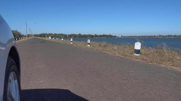 Outside car speed running on the road highway and there is a reservoir beside the way video