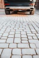 Professional laying of road stone and paving slabs for walking and parking - sidewalk paving photo