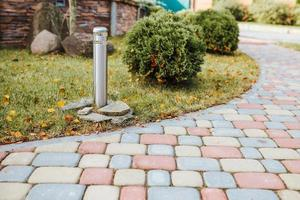 Decorative sturdy concrete tiles for walkways, patios and backyard parking - pavement for the lot outside the house - country house planning and architecture photo