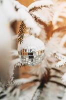 Mirror ball on the new year tree - Christmas toys decorate the fir tree photo