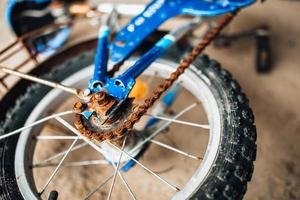 Old broken abandoned bike - rusty unmaintained without pedals photo