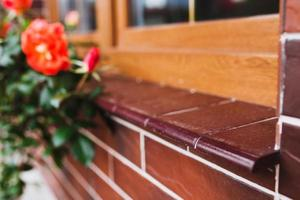 Dark brown ceramic tiles for finishing the facade of the house - floor and walls imitation red brick - glossy glaze photo