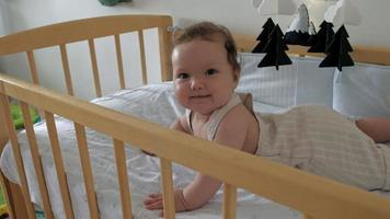 Baby learning to keep her head up on a crib video