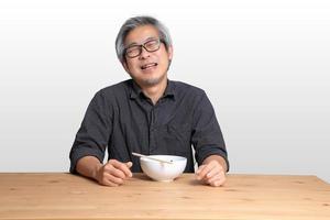Asian Man Sitting photo