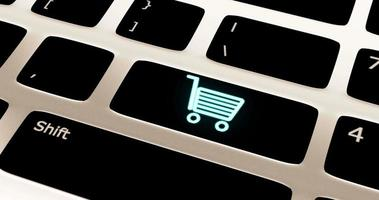 A blue shopping trolley sign blinks on a keyboard video