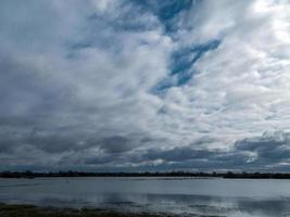 Dramatic cloudy sky over Wheldrake Ings Nature Reserve North Yorkshire England photo