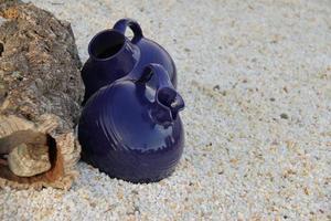 Garden decoration blue ceramic pot on stones photo