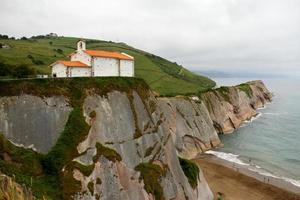 Editorial usage, Dragon stone, Itzurun beach, Santa Telma chapel, Zumaia, Basque Country, Atlantic ocean, Spain photo