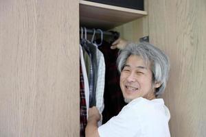 Asian Man with Wardrobe photo