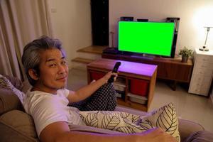 Asian Man Watching Television photo