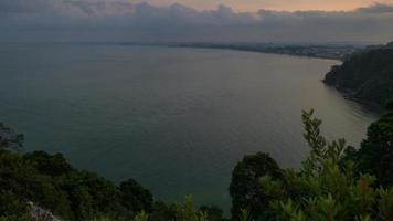 Timelapse of a cloudy sunrise over the sea, top view from a hill video