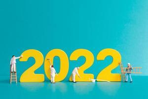 Equipo de trabajadores de personas en miniatura pintura número 2022 foto