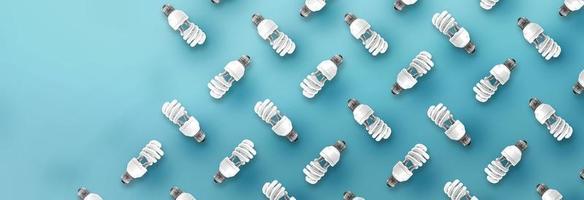 patrón de bombilla de luz fluorescente sobre fondo azul. foto
