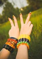 Symbol of pacifism. Beautiful ethnic bracelets. International Day of Peace photo