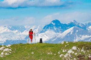 A walk in the mountains a woman with her dog friend photo