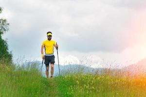 Nordic walking in mountain meadow photo