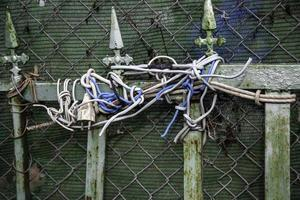 Tangled cables in door photo