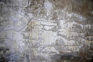 Chipped stone wall photo