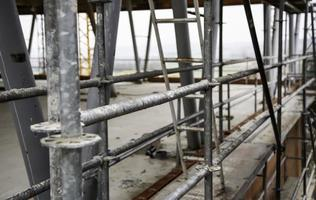 Metal scaffolding on construction site photo
