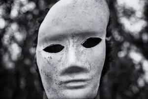 Scary mask in forest photo