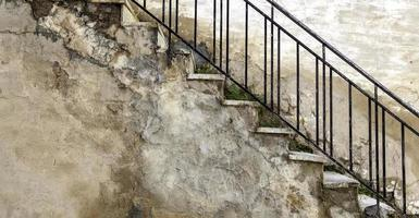 Stone stairs with handrails photo