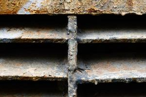 Close-up of rusty metal lattice wall photo
