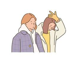 Two women in winter coats. hand drawn style vector design illustrations.
