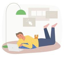 A man is lying on a cushion and looking at a laptop, with a cat behind him. vector