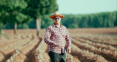 Young farmer standing and looking camera and smiling proudly video