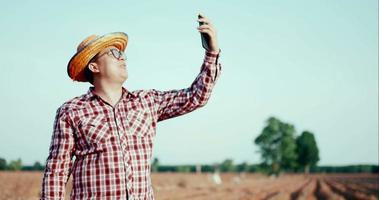 Happy young farmer use smartphone selfie or video call