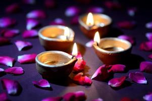 Traditional clay diya lamps lit during Diwali celebration photo