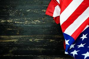 American flags on black wood background photo