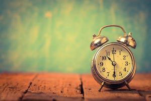 Alarm clock on vintage background photo