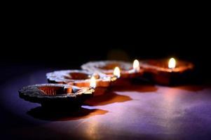 Colorful clay Diya, Lantern lamps lit during Diwali celebration. Greetings Card Design Indian Hindu Light Festival called Diwali. photo