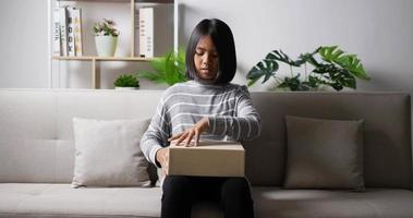 Teen girl opening gift box video