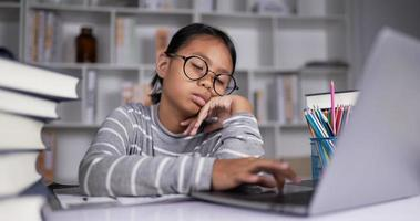 Female sleeping on book while studying online at home video
