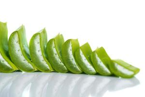 Slices of Aloe Vera leaves and Aloe Vera gel on a white background. Aloe Vera is a very useful herbal medicine for skincare and hair care. photo