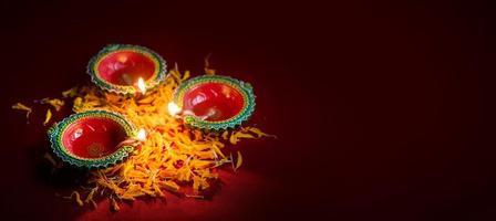 Happy Diwali - Clay Diya lamps lit during Diwali celebration. Greetings Card Design of Indian Hindu Light Festival called Diwali photo