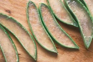 Close-up Fresh Aloe vera sliced on a chopping board photo