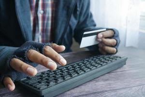hacker hand stealing data from credit card photo