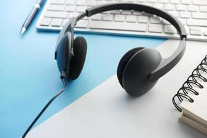 call center headphone on laptop on table , photo