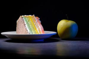 green apple and a bakery cake on black background photo