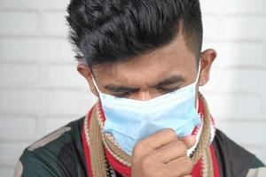 young sick man coughing and sneezes photo