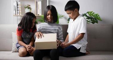 Three kids opening gift box video