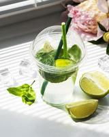 Mojito cocktail  with lime and mint photo